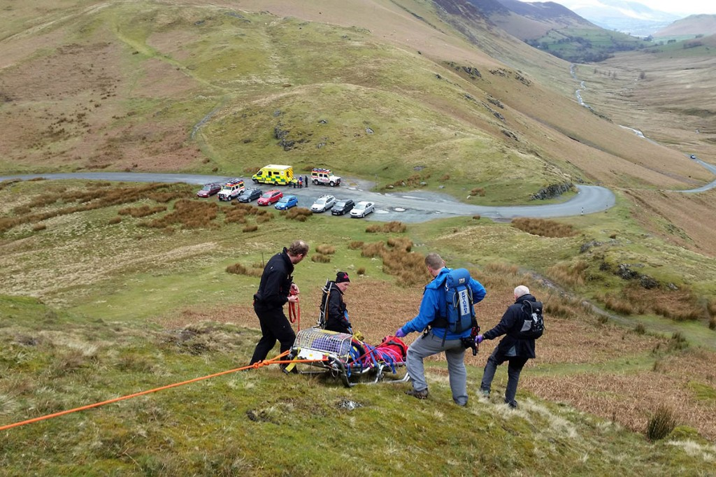 Cockermouth team members stretcher the injured walker from the fell. Photo: Cockermouth MRT