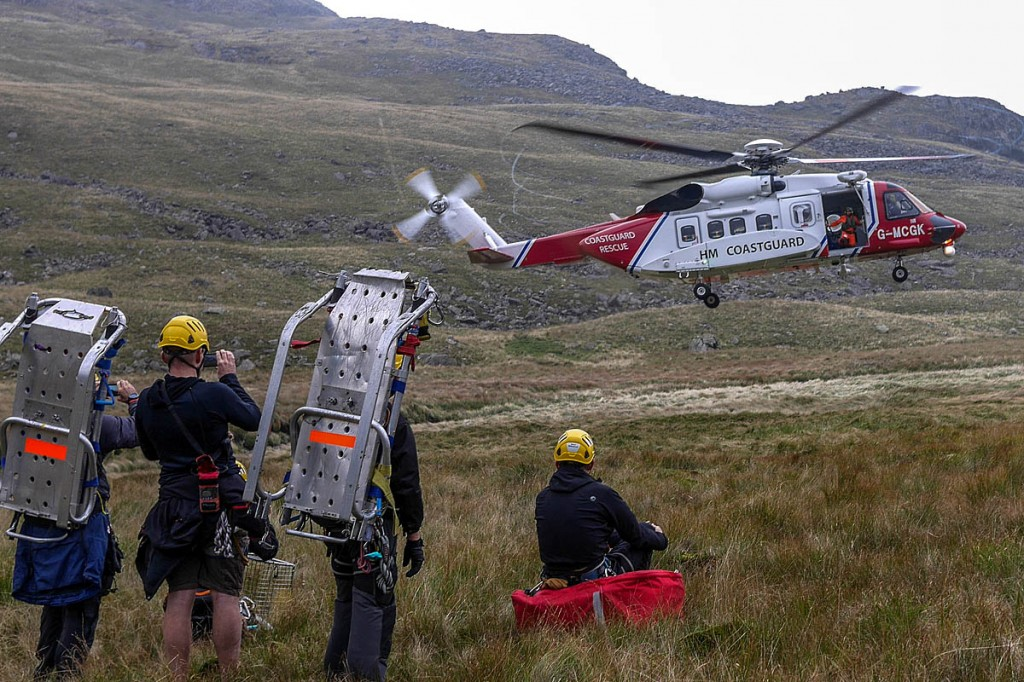 Rescuers at the scene with the Coastguard helicopter. Photo: Cockermouth MRT