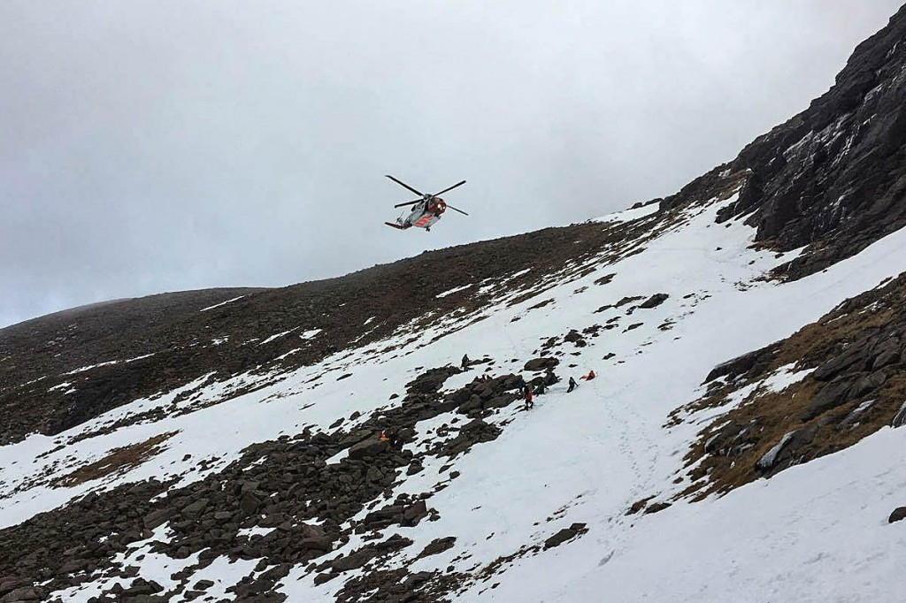 The Coastguard helicopter and rescuers at the scene in Coire an t-Sneachda. Photo: Ian Goodall