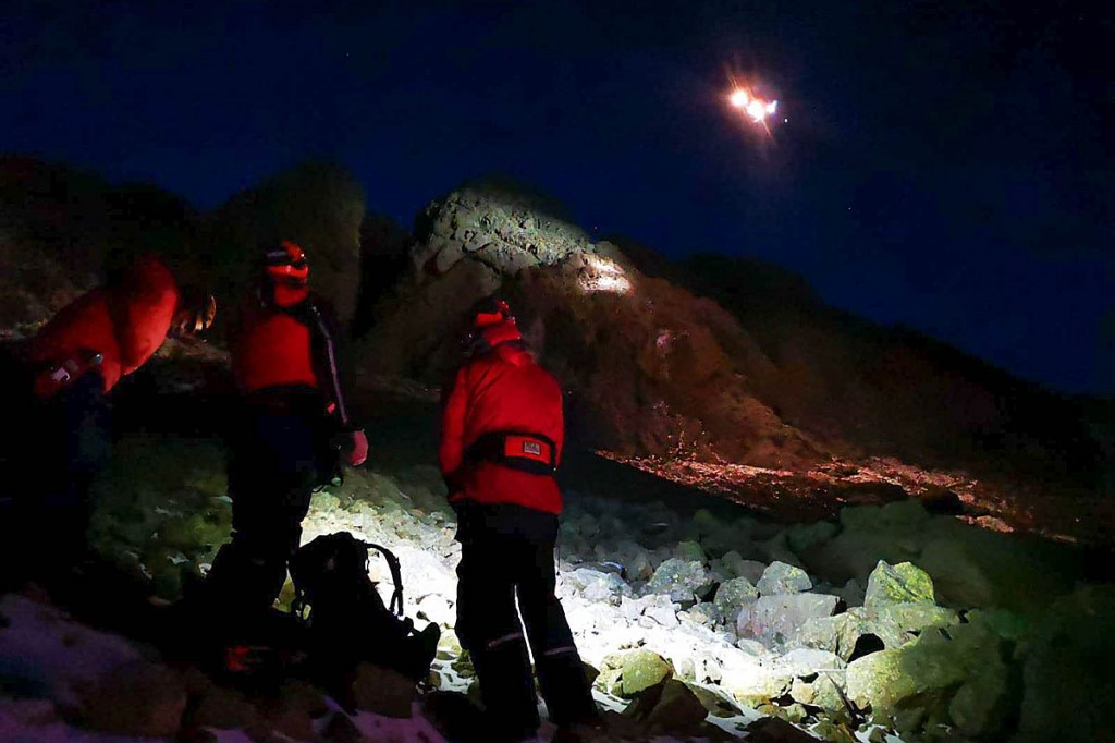 Rescuers and the Coastguard helicopter at the scene on Dow Crag. Photo: Coniston MRT