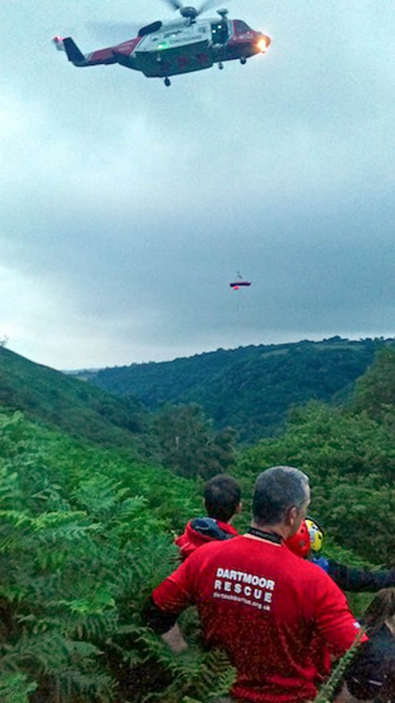 Rescuers and the Coastguard helicopter at the scene. Photo: Dartmoor SRT Ashburton