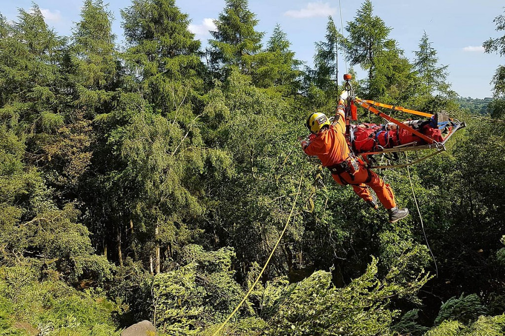 The injured climber is winched into the helicopter. Photo: Derby MRT