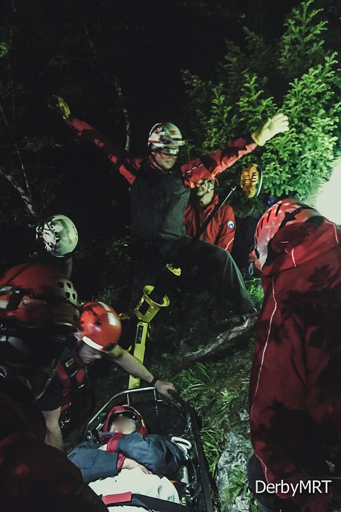 Rescuers with the fallen walker at the scene near Matlock Bath. Photo: Derby MRT