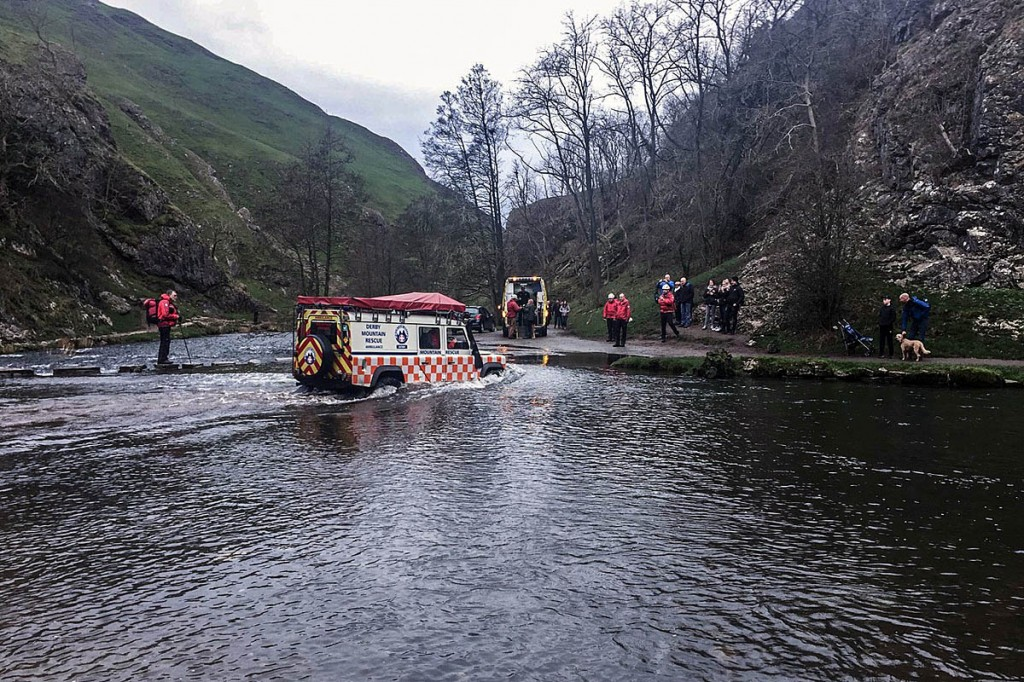 The injured walker is driven over the River Dove in the team's Land Rover. Photo: Derby MRT