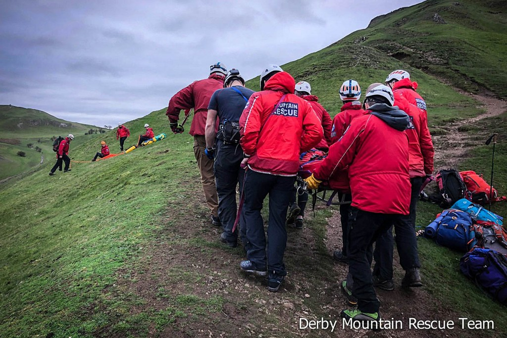 The man is stretchered from the hill. Photo: Derby MRT