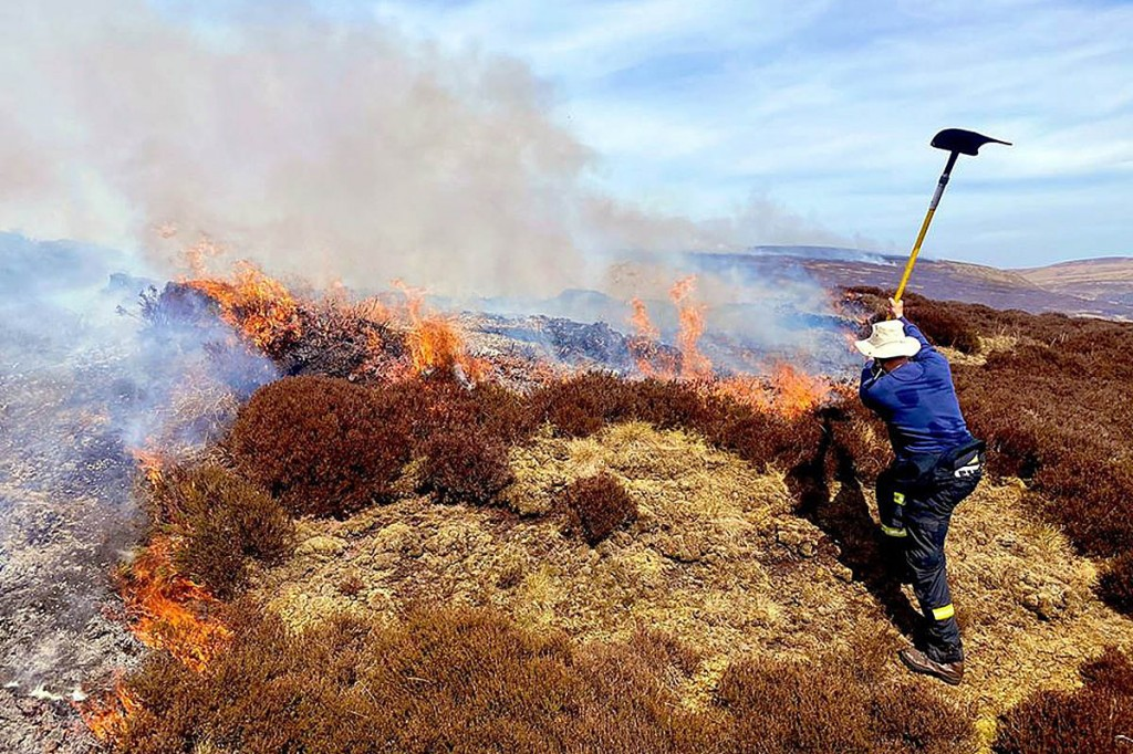 Beaters are one method being used to fight the Rakes Moss fire. Photo: Derbyshire Fire and Rescue Service