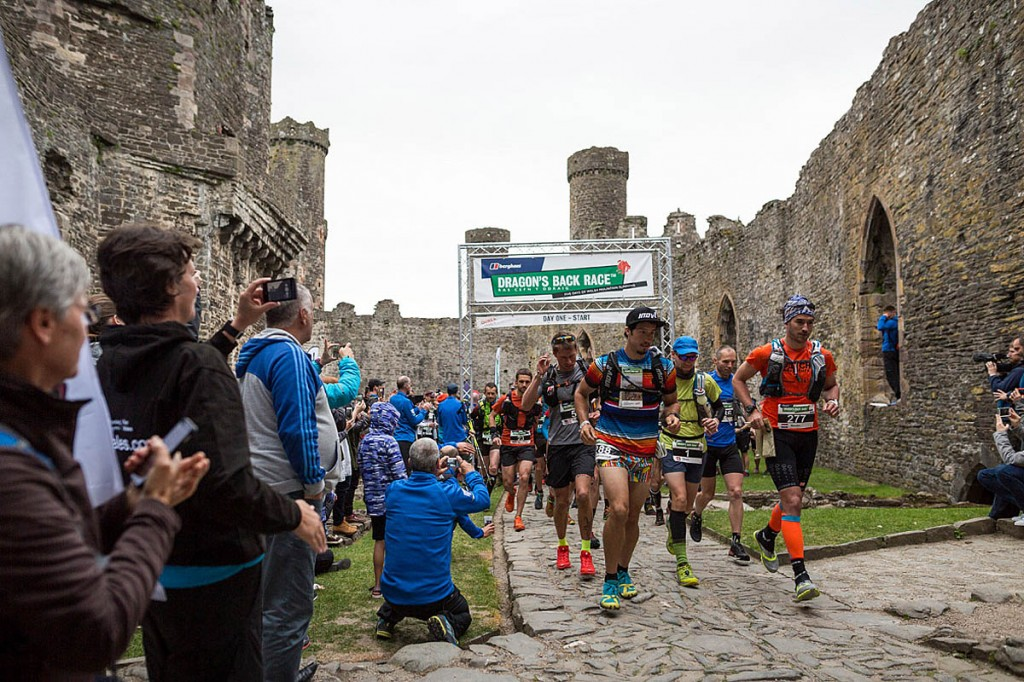 Runners leave Conwy Castle at the start of the race