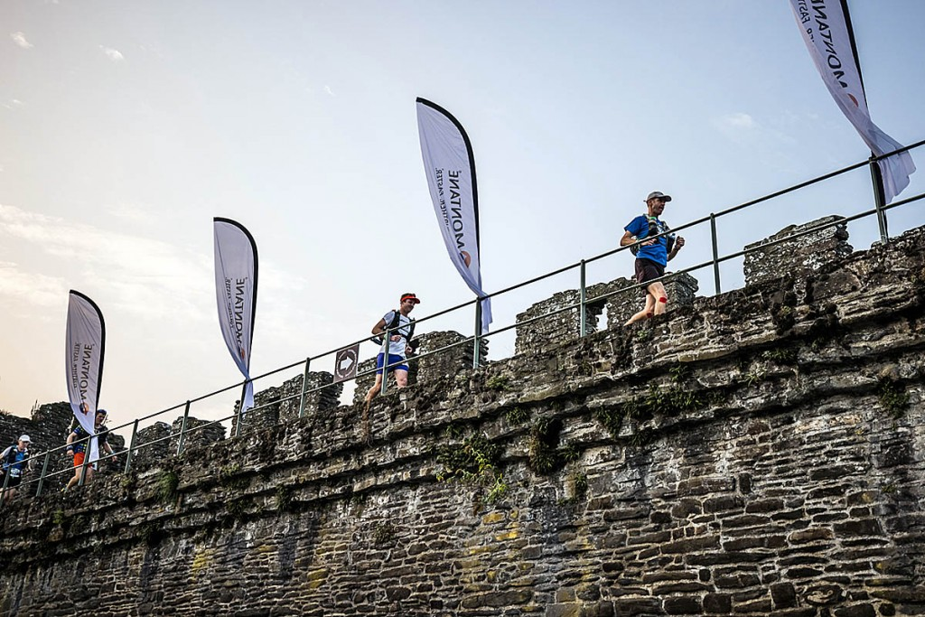 Runners head along the walls of Conwy Castle at the start of the race. Photo: No Limits Photography