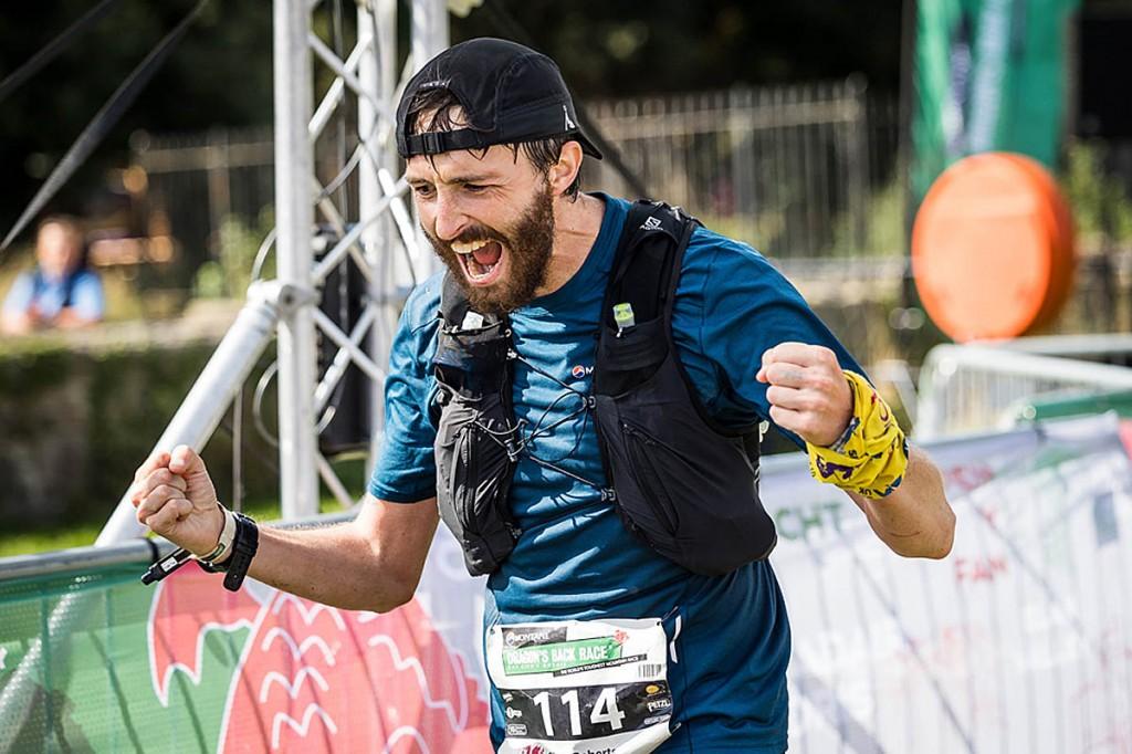 A jubilant Simon Roberts crosses the finishing line. Photo: No Limits Photography