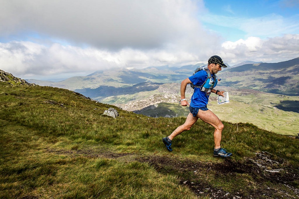 Jim Mann strides across the Welsh mountains during the race. Photo: Ian Corless