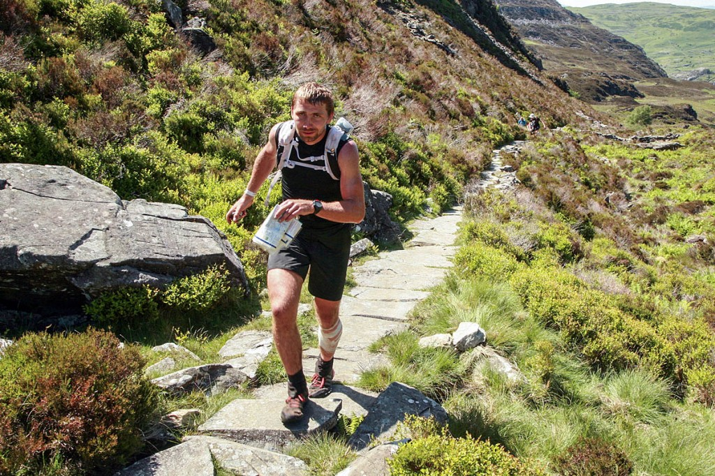 Pavel Paloncy is continuing to run despite having a leg wound stitched. Photo: Rob Howard