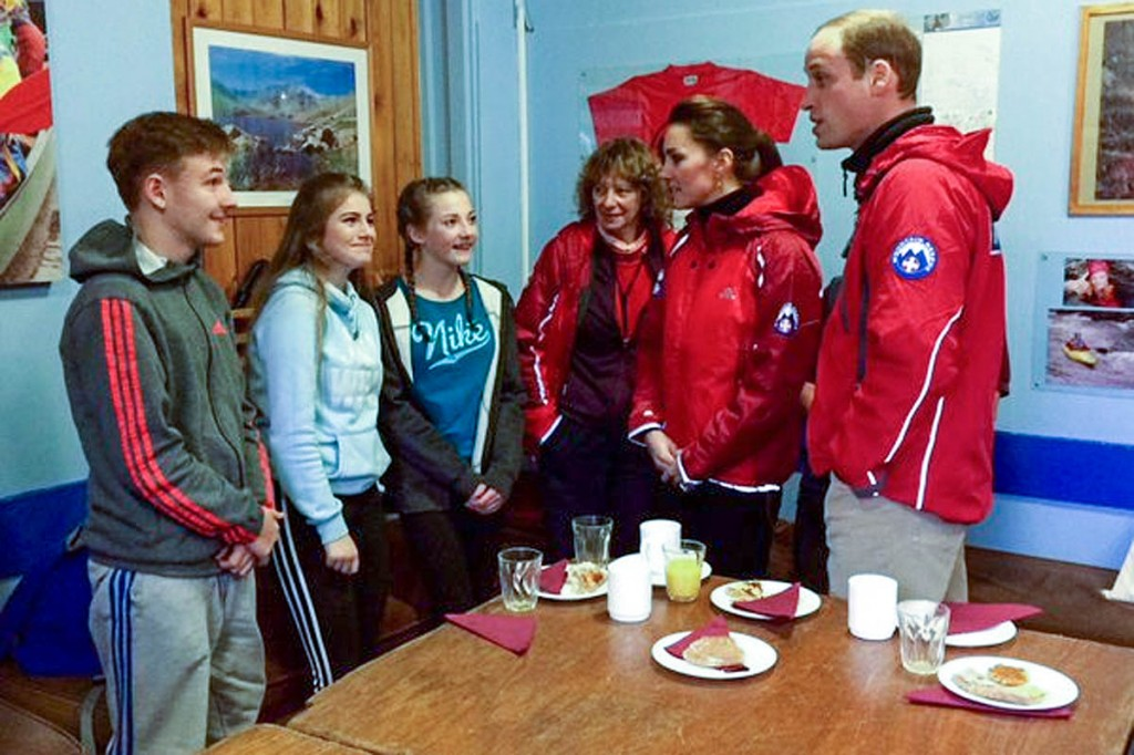 The duke and duchess talk to young people during their visit to the outdoor education centre