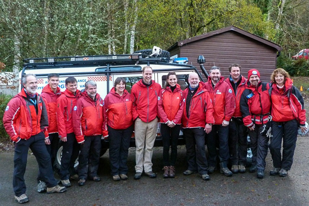 The royal couple line up with mountain rescuers, including Chris Lloyd, left, and Mike France, to the right of the duchess