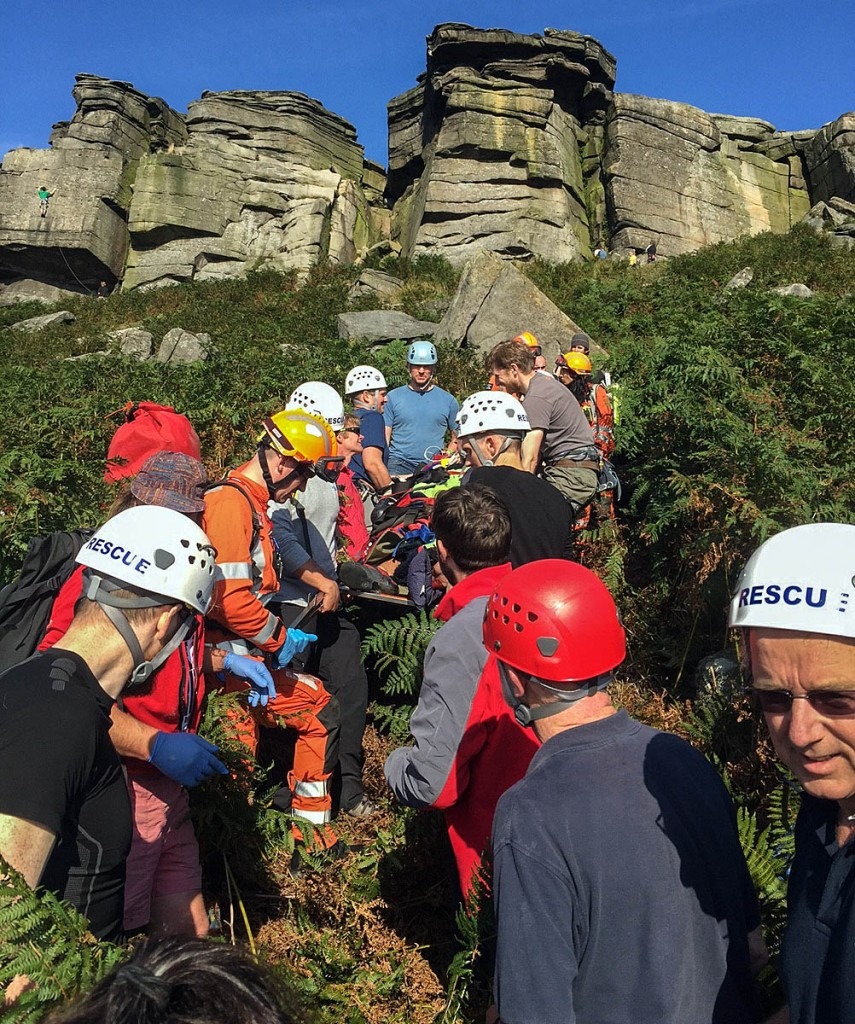 Team members stretcher the climber from Stanage Edge. Photo: Edale MRT
