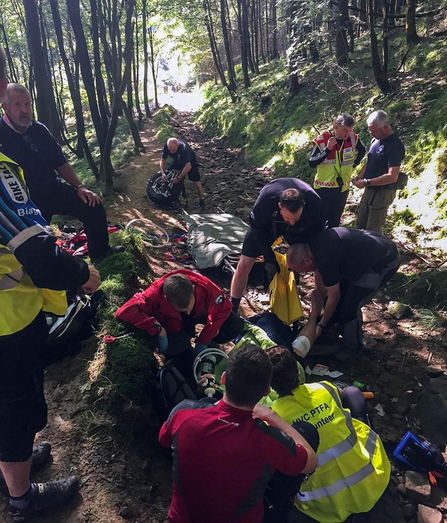 Team members tend to the injured mountain biker. Photo: Edale MRT