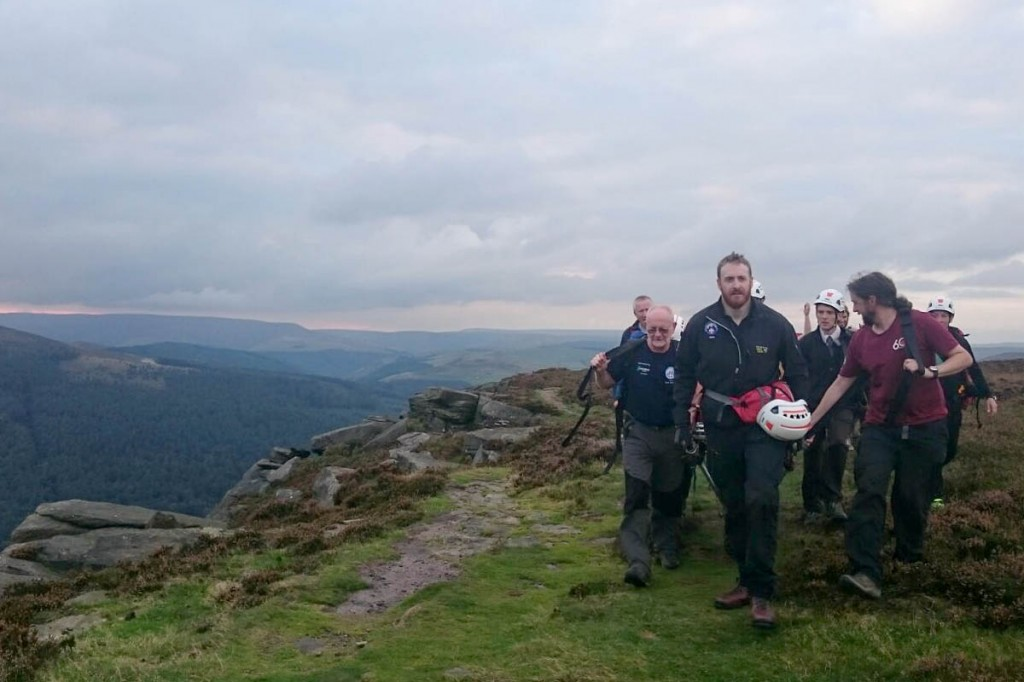 The team stretchers the injured climber from the crag. Photo: Edale MRT