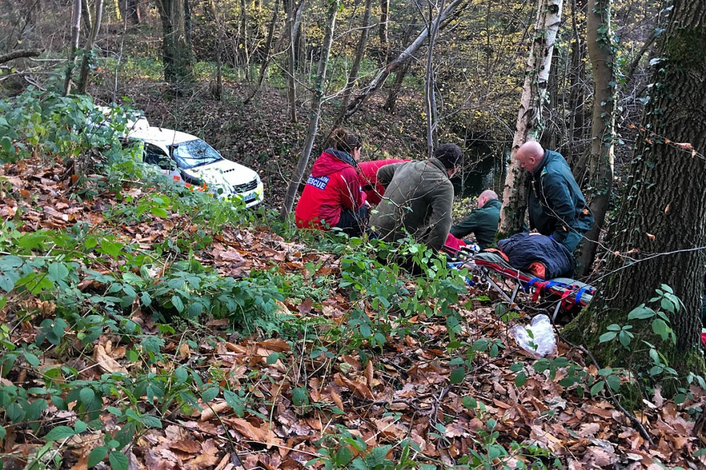 Rescuers at the scene in Linacre Wood. Photo: Edale MRT