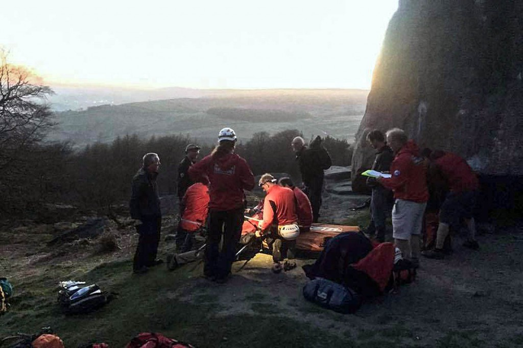Team members in action treating the fallen boulderer on Stanage Edge. Photo: Edale MRT