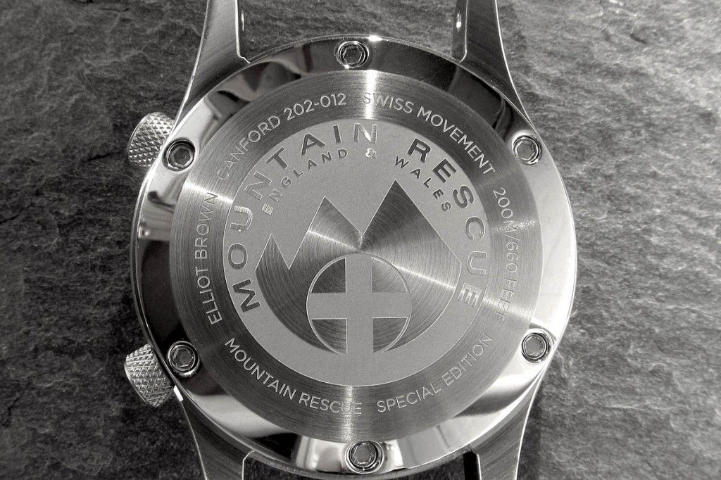 The watch has the mountain rescue logo on its case back