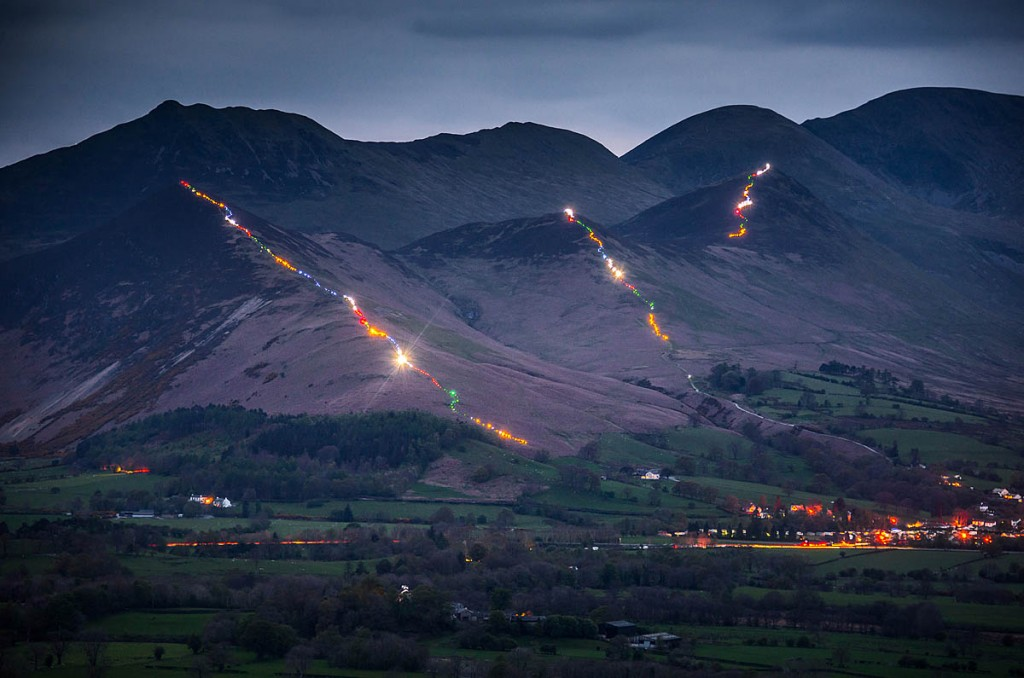 The three fells are illuminated by walkers' headtorches. Photo: Tom McNally