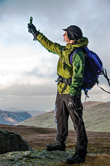 Fell-top assessor Jon Bennett tests weather conditions on Helvellyn