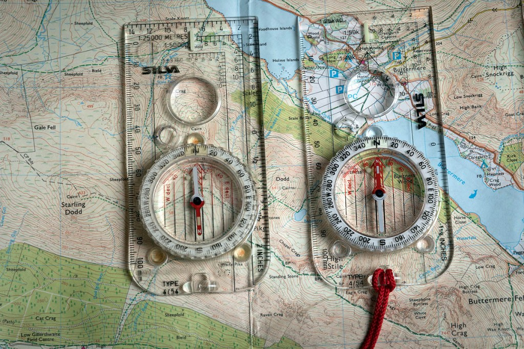 The compass on the left has a flipped needle, pointing in the wrong direction. The right-hand compass is indicating the correct northernly direction. Photo: Bob Smith/grough