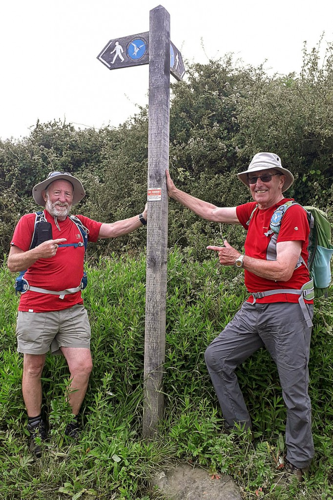 Steve Hayward and Eric Chambers of the Friends of Anglesey Coastal Path place the final plaque