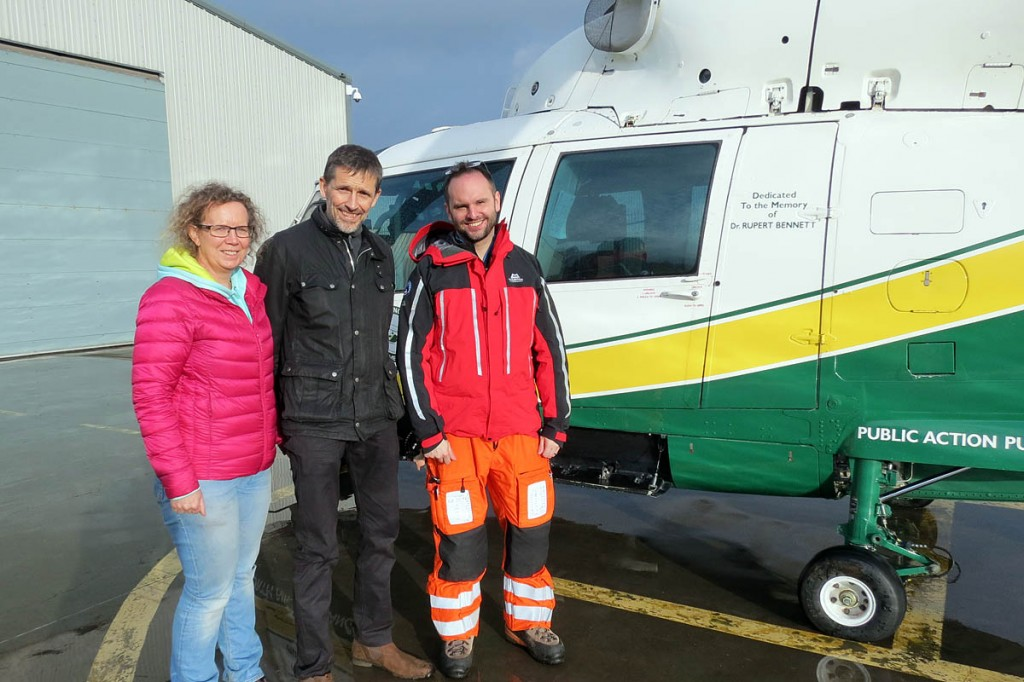Alexandra and Michael Conroy Harris with air ambulance doctor John Ferris