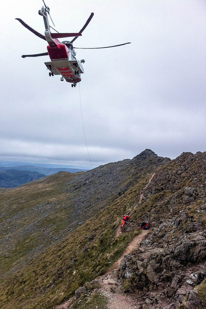 The Coastguard helicopter prepares to winch the fallen walkr from Striding Edge. Photo: GNAAS