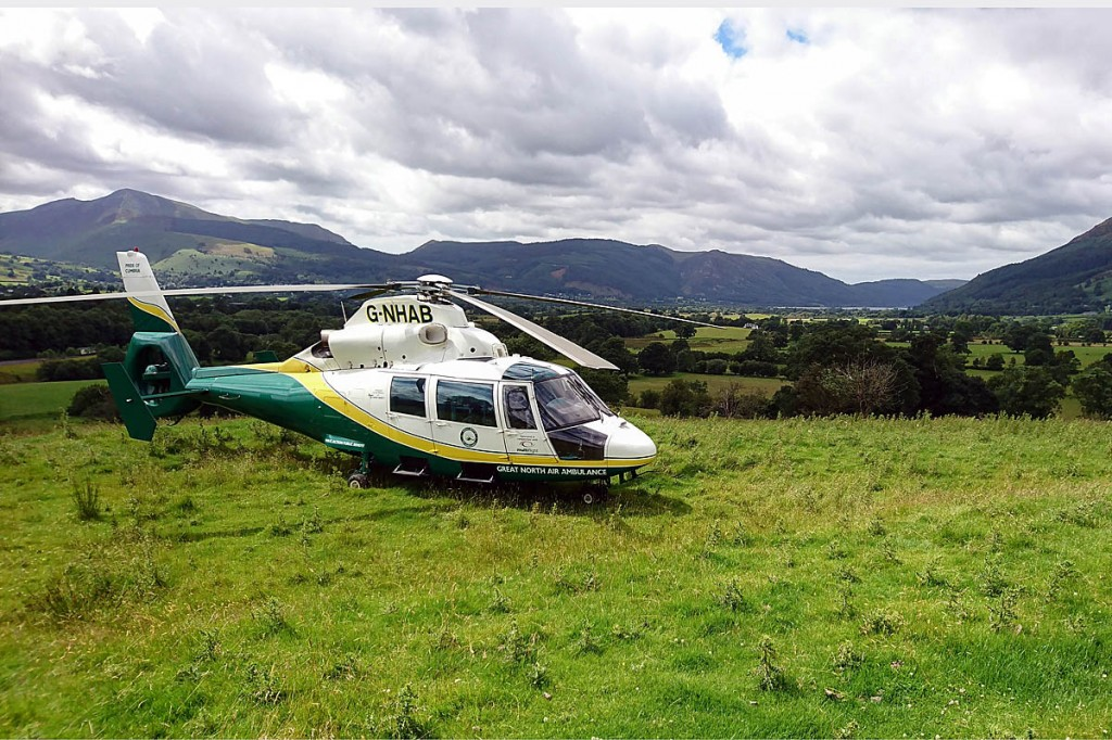 The Great North Air Ambulance Service helicopter at the scene on Latrigg. Photo: GNAAS