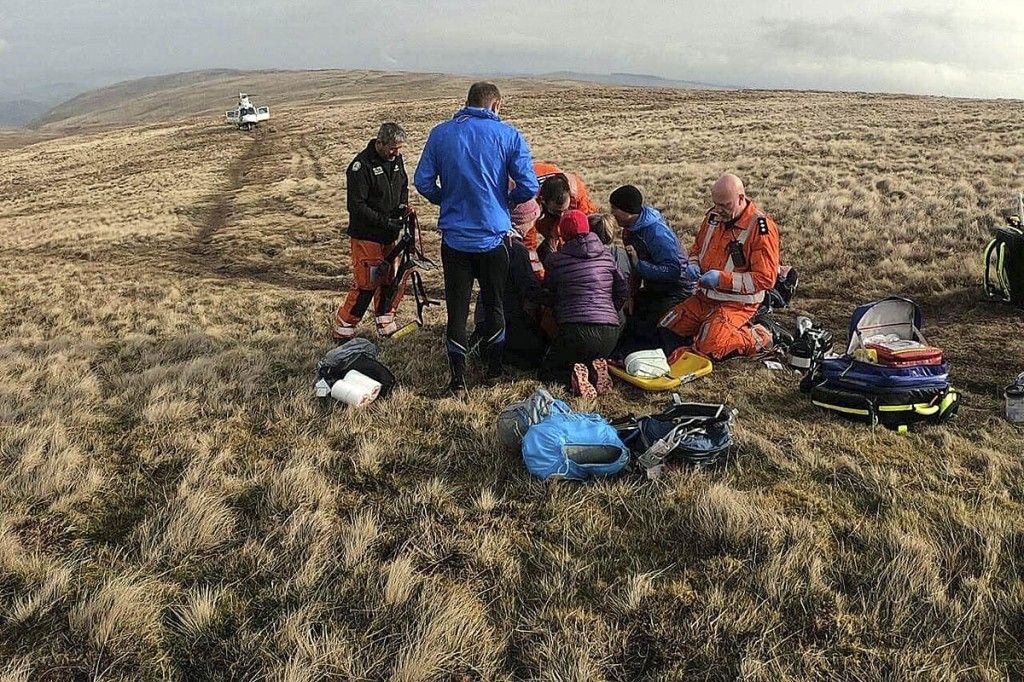 The air ambulance crew treats the runner at the scene on Loadpot Hill. Photo: GNAAS