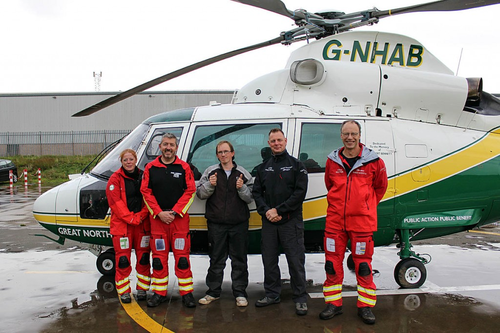 Christian Unsworth with, from left, GNAAS paramedic Sarah Graham, pilot Phil Lambert, paramedic Andy Dalton and doctor Theo Weston
