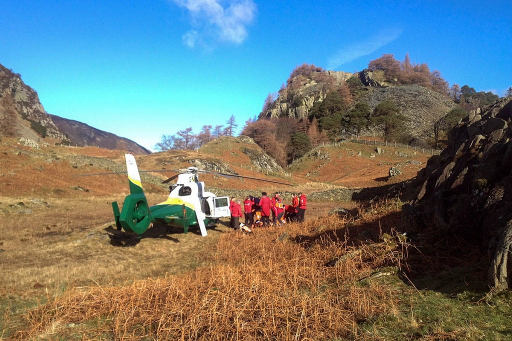 Rescuers and air ambulance crew at the scene on Castle Crag. Photo: GNAAS