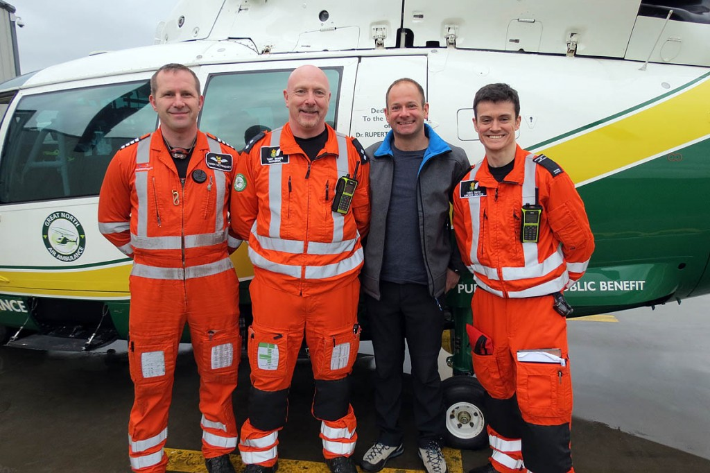 Dave Tighe meets Great North Air Ambulance pilot Owen McTaggart, left, paramedic Terry Sharpe and Dr Chris Smith, right. Photo: GNAAS
