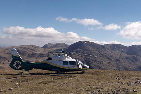 The Pride of Cumbria helicopter on Green Gable during the rescue. Photo: GNAAS