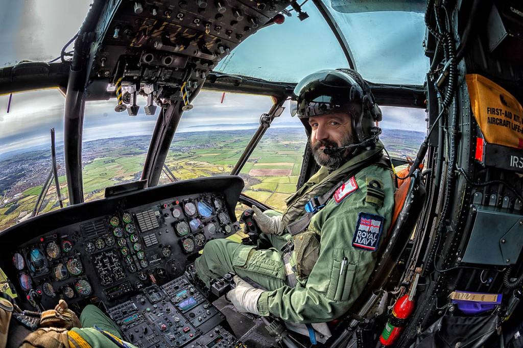 Lieutenant Commander Charlie Fuller at the controls of the Sea King. Photo: Royal Navy