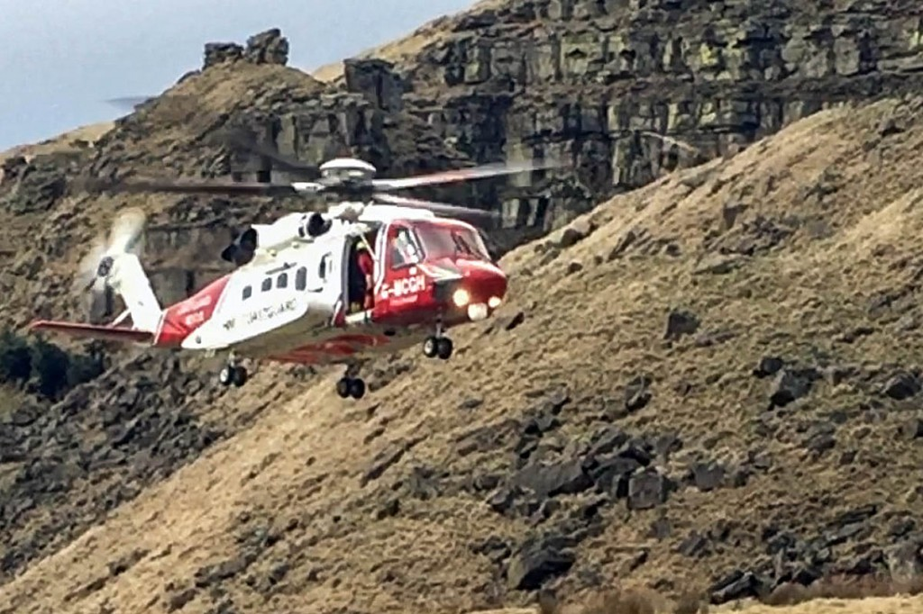 The Coastguard helicopter in action during the Alport Castles rescue. Photo: Glossop MRT