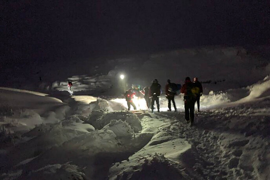 The group was accompanied off the hill by rescuers. Photo: Glossop MRT
