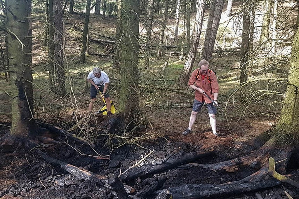 Volunteers help put out the fires in woods near Snake Summit. Photo: Glossop MRT