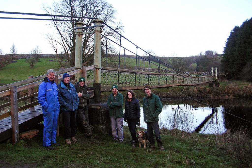 Workers and authority staff at Hebden Supension Bridge. Photo: Yorkshire Dales NPA