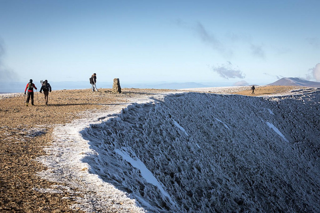 Walkers on the summit of Helvellyn in the Lake District. Photo: Bob Smith/grough