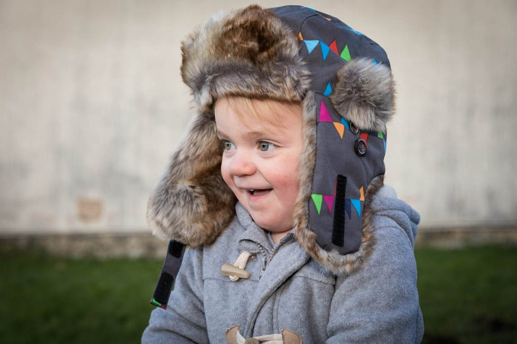 Stanley, two, keeps himself warm with the Isbjörn Squirrel Winter Cap. Photo: Bob Smith/grough