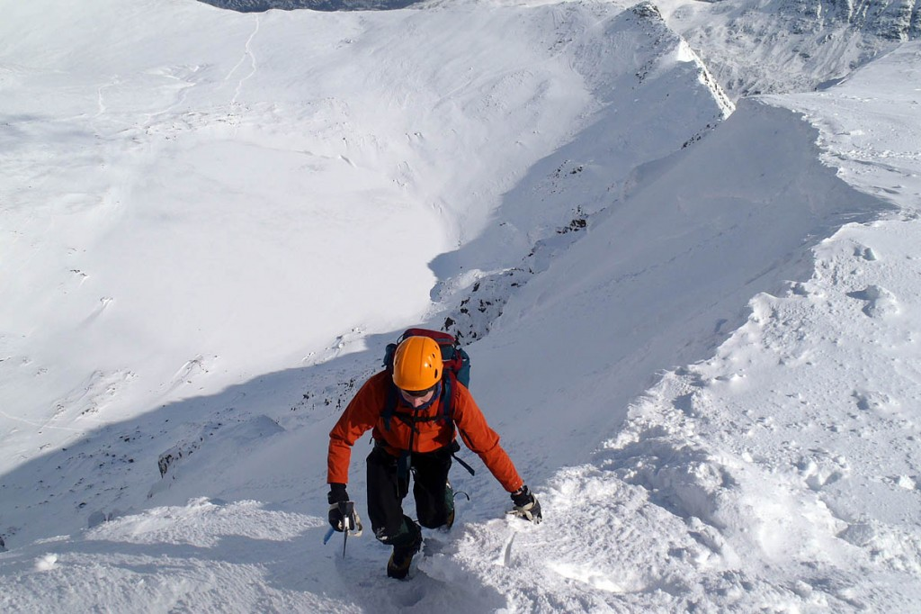 A winter climber tops out on Helvellyn