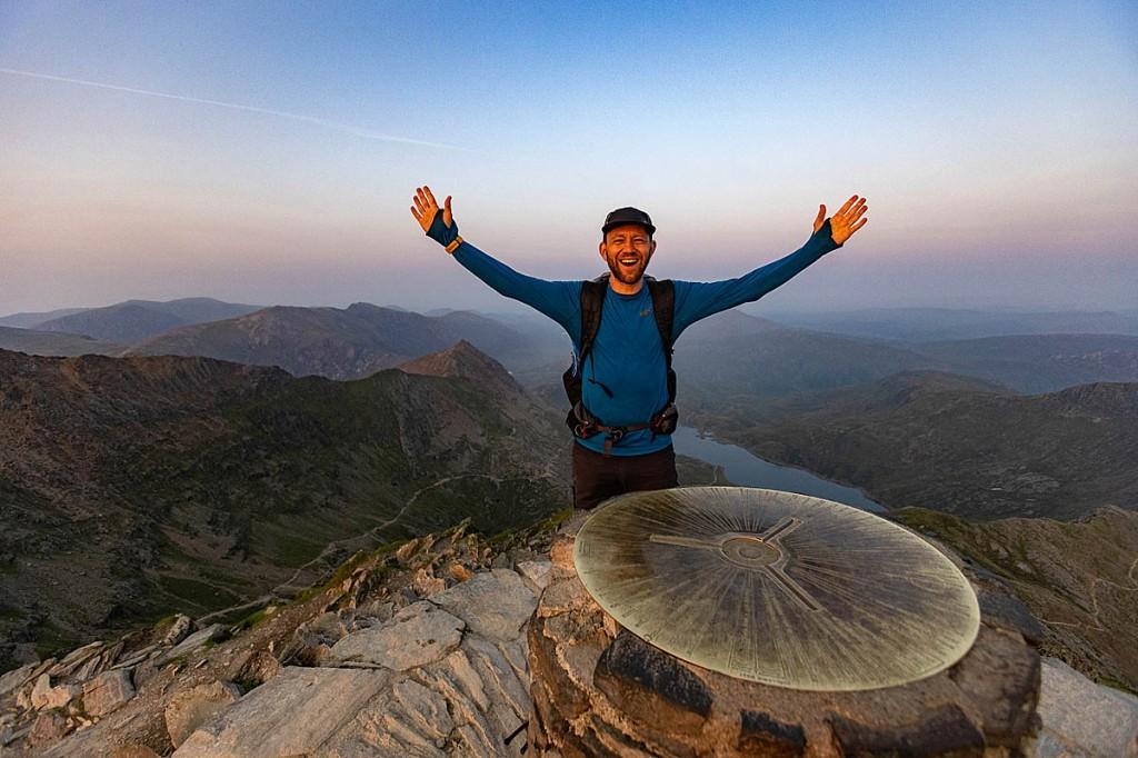 James Forrest celebrates reaching the summit of Yr Wyddfa-Snowdon. Photo: inov-8.com/Dave MacFarlane