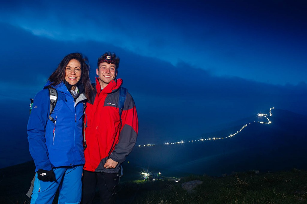 Julia Bradbury and Sam Thompson on the Great Ridge, with the string of headtorches in the background. Photo: Ali Cusick