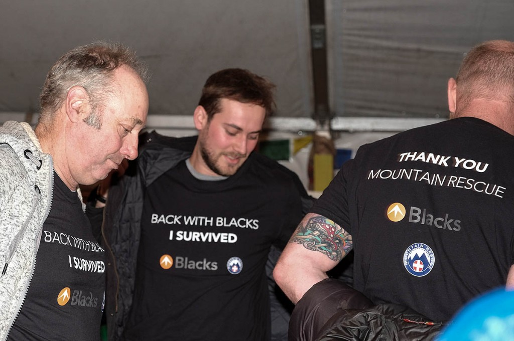 John France, left, reveals his 'I survived' t-shirt at Kendal Mountain Festival