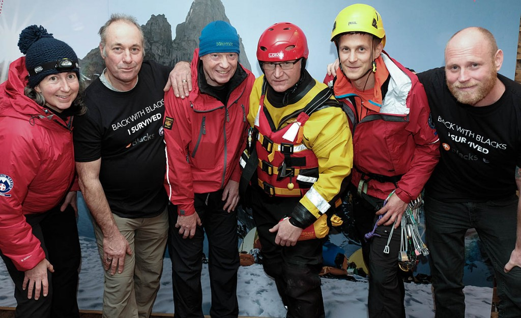 John France, second from left, and Joe Beaumont, right, meet mountain rescuers at the Kendal Mountain Festival
