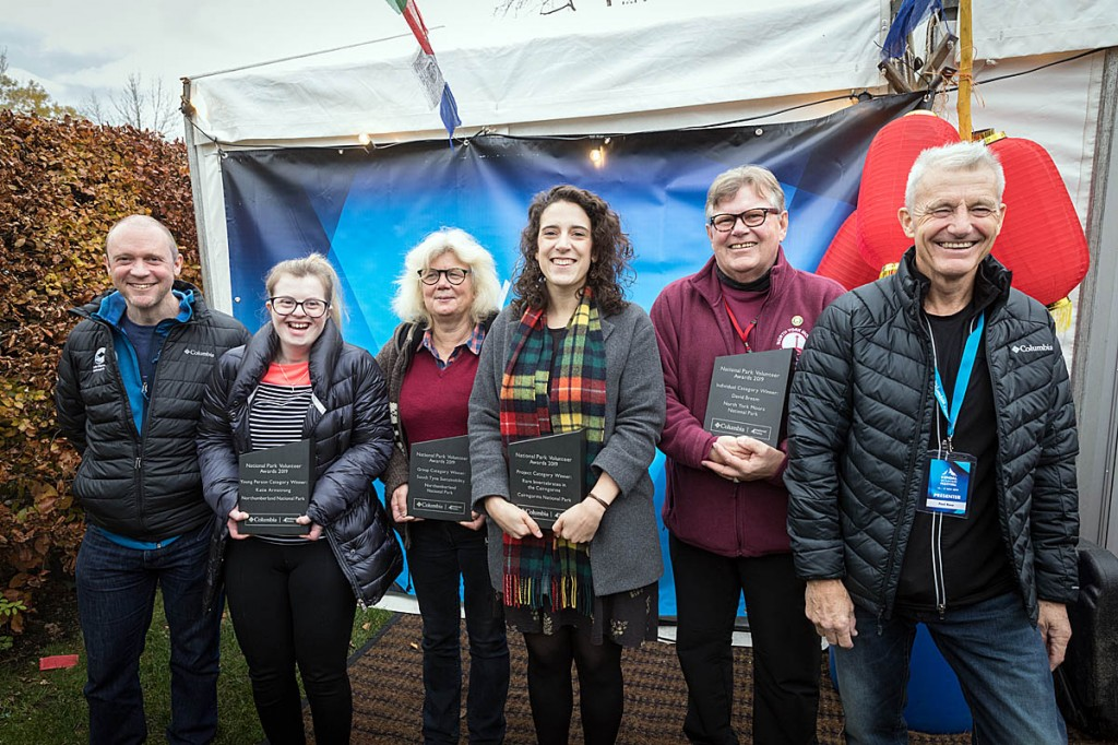 Paul Rose, right, and Lake District National Park Authority chief executive Richard Leafe, left, join award winners at the Kendal Mountain Festival. Photo: Bob Smith/grough