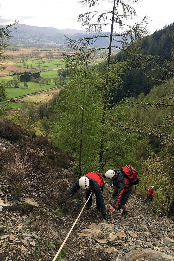 Rescuers used a rope to enable the walker to descend to safer ground. Photo: Keswick MRT