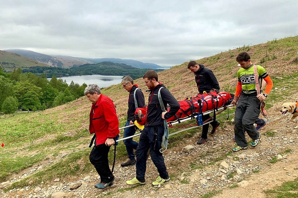 The injured runner is stretchered from the fell. Photo: Keswick MRT